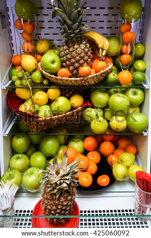 Fruit and vegetable refrigerator. Fresh fruit mini bar fridge for self service. Healthy lifestyle. - stock photo
