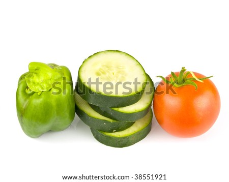 Fruit and vegetables arranged on a white background