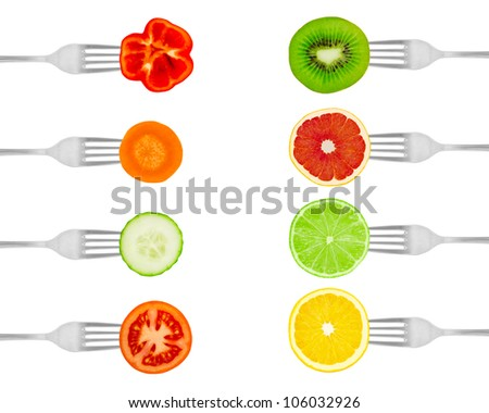 Fruit and vegetables on forks isolated on a white background - stock photo