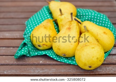 Fruit background. Fresh organic pears on wood. Pear autumn harvest - stock photo