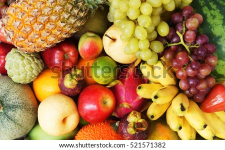 Fruit background, many fresh fruits mixed.