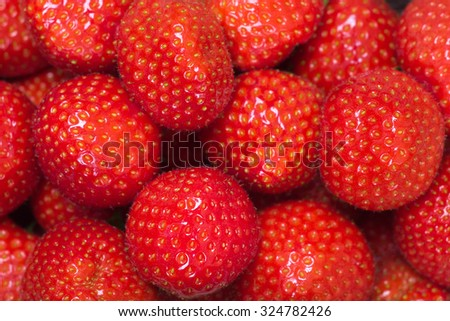 Fruit background, strawberries at a local market - stock photo