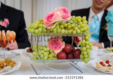 Fruit basket on the wedding table - stock photo