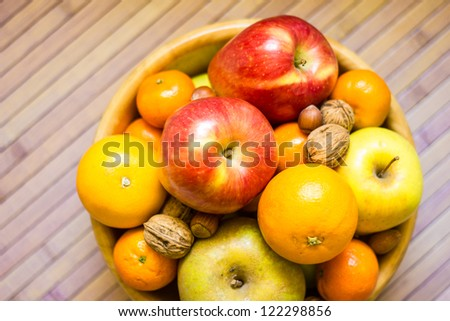 Fruit basket with apples tangerines and oranges