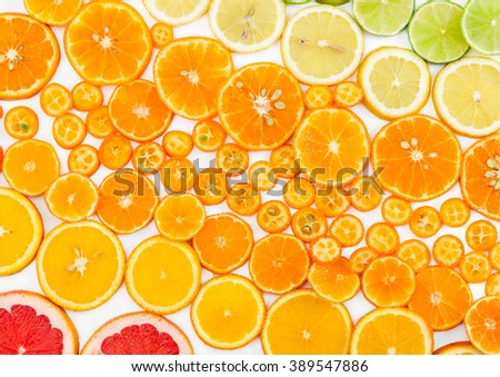 Fruit citrus background with grapefruit, orange, tangerine, lemon, lime and kumquat. Top view. Flat lay. - stock photo