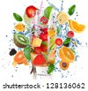 Fruit Cocktail with splashing liquid isolated on white - stock photo