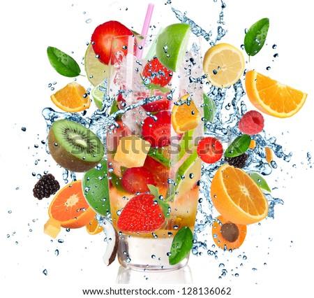 Fruit Cocktail with splashing liquid isolated on white - stock photo