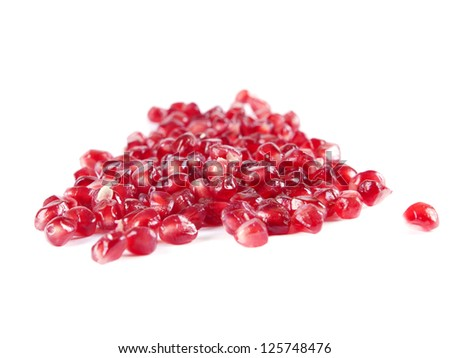 fruit composition from garnet berries on a white background - stock photo