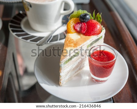 fruit crape cake with coffee in cafe