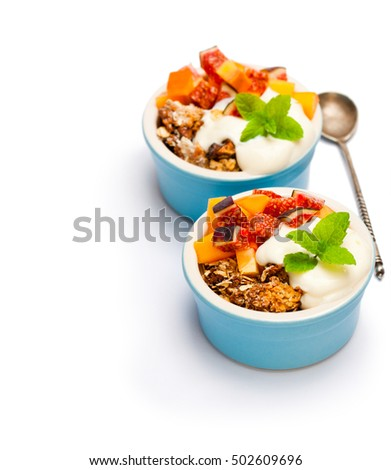 fruit  crumble with oat flakes and persimmon and fig isolated on white