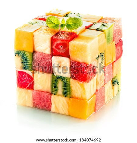 Fruit cube formed from small squares of assorted tropical fruit in a colorful arrangement including kiwifruit, strawberry, orange, banana and pineapple on a white background - stock photo