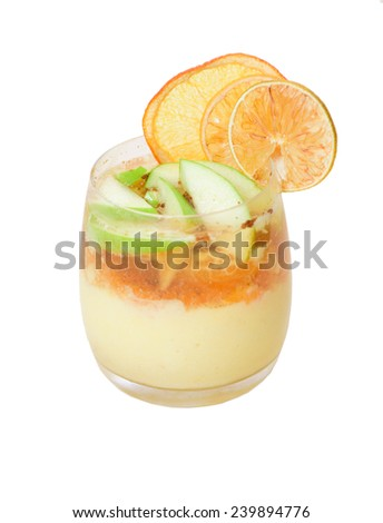 Fruit dessert with custard and citrus - stock photo