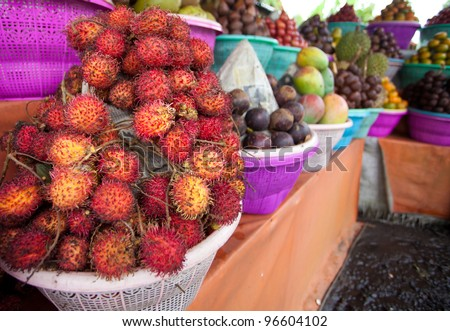Fruit display on small streetside stall in Bali - stock photo