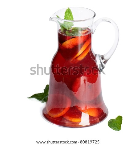 Fruit drink in jug  Isolated on white - stock photo