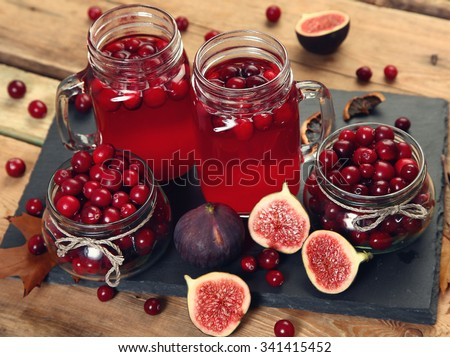 fruit drink on wooden table - stock photo