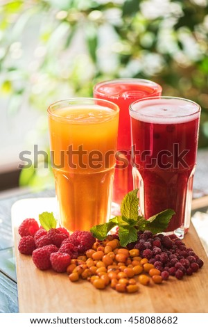 fruit drink with cranberries raspberries and sea buckthorn - stock photo