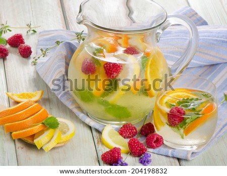 Fruit drink with fresh berries and mint leaves. Selective focus - stock photo