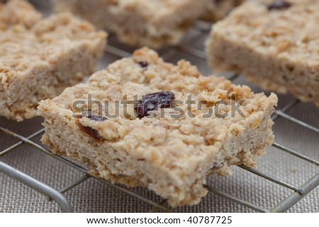 Fruit flapjack on a cooling tray - stock photo