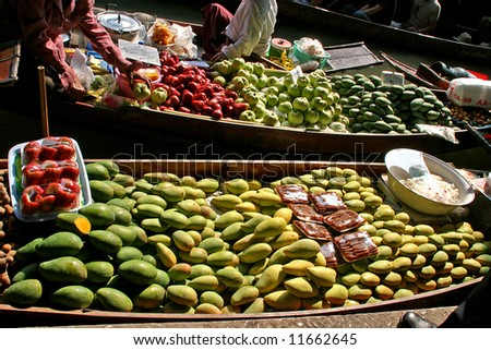 Fruit for sale on a boat at the floating market - stock photo