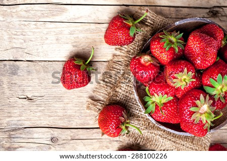 fruit. Fresh strawberries on old wooden background - stock photo