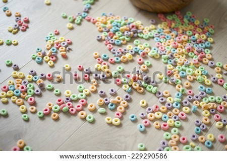 fruit (froot) loops spilled on floor - stock photo