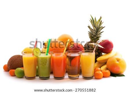 Fruit. Glasses colorful of fruit juices close up on white background  - stock photo