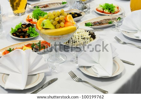 fruit in a vase on the holiday table - stock photo