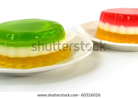 Fruit jelly dessert on a white plate. - stock photo