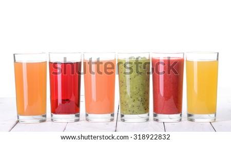 Fruit juice ( grape , strawberries , orange , kiwi , grapefruit , apple )  Isolated on white background. - stock photo