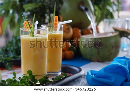 Fruit Juice made from coconut sap and oranges - stock photo