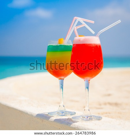 fruit  juicy  alcoholic cocktails in sea tropical  Maldives  romantic  atoll island paradise luxury  resort . Coconuts