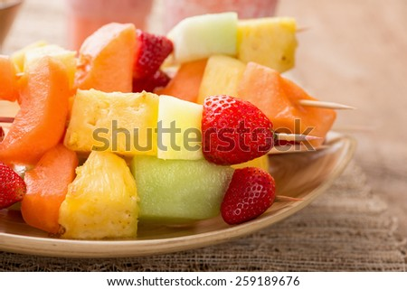 Fruit kabobs - fruit on skewers - on tray with strawberry smoothies - stock photo