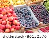 Fruit Market.  A fruit stand selling plums, grapes, nectarines, apricots , pears and other fresh fruit. - stock photo