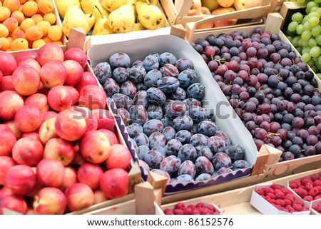 Fruit Market.  A fruit stand selling plums, grapes, nectarines, apricots , pears and other fresh fruit.