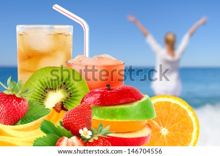 Fruit mix and cocktail on a beach background - stock photo