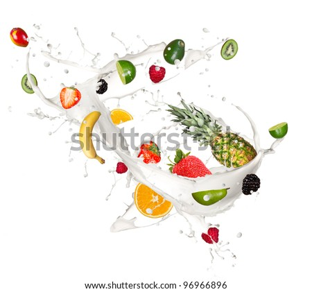 Fruit mix in milk splash, isolated on white background