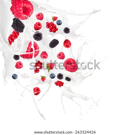 Fruit mix, strawberry, blueberry, raspberry and currant in milk splash, isolated on white background - stock photo