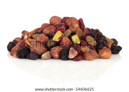 Fruit nut and berry snack food mixture isolated over white background. - stock photo