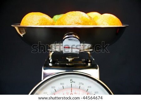 Fruit on kitchen scales.