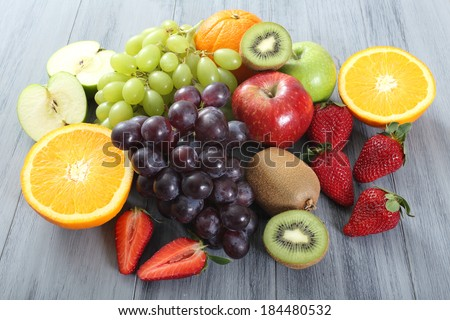 fruit on wooden table - stock photo