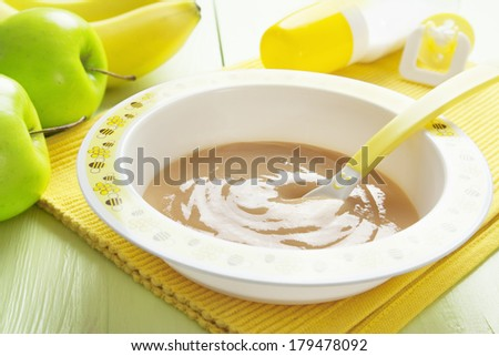 Fruit puree in a bowl on the table, baby food