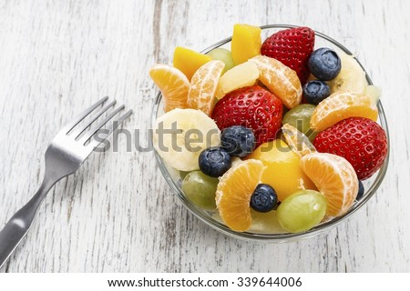 Fruit salad in glass bowl - stock photo