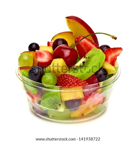 Fruit salad in takeaway cup on white background - stock photo