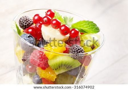 Fruit salad mix on the wooden table