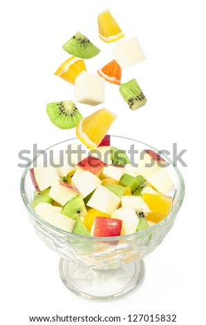 fruit salad with kiwi, apples and oranges
