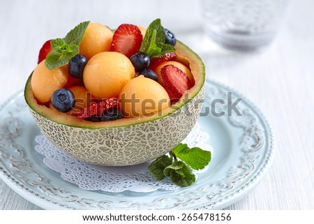 Fruit salad with melon, strawberry and blueberry - stock photo