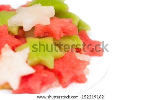 Fruit salad with melon, watermelon and kiwi, isolated on white - stock photo