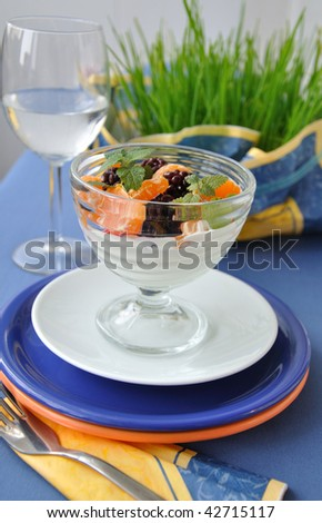 fruit salad with orange and blueberry - stock photo