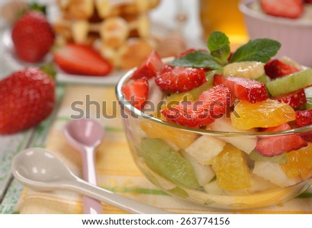 Fruit salad with strawberries - stock photo