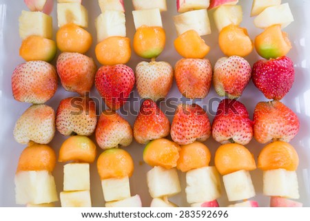 fruit salad with strawberry apple and cantaloupe - stock photo